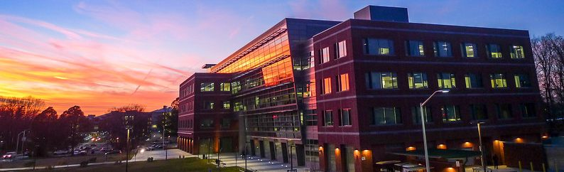 """Alan and Sally Merten Hall at sunset. Photo by Evan Cantwell/George Mason University"""